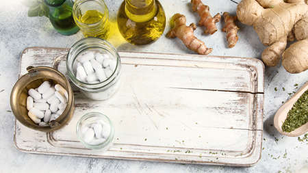 Healing herbs, essential oils and homeopathic pills. Homeopathy and Alternative Medicine Stock Photo