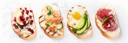 Small sandwiches set. Italian brushetta or spanish tapas  Фото со стока