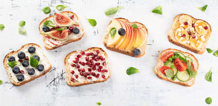 Healthy summer toasts for breakfast. Top view. Panorama Stock Photo