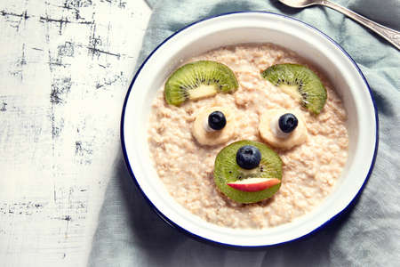 Oatmeal porridge for healthy kids breakfast. Stock Photo