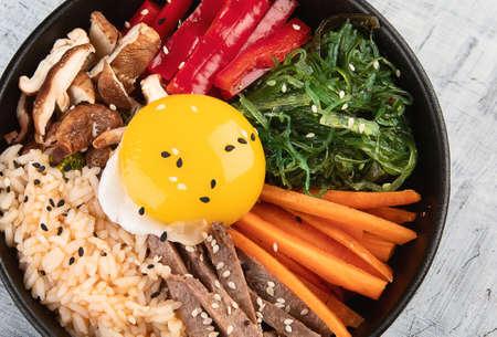Bibimbap - traditional Korean dish with rice, vegetables, beef