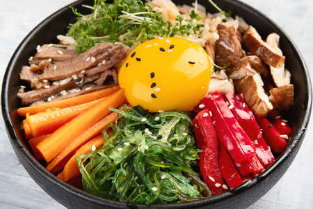 Bibimbap - traditional Korean dish with rice, vegetables, beef Stock Photo