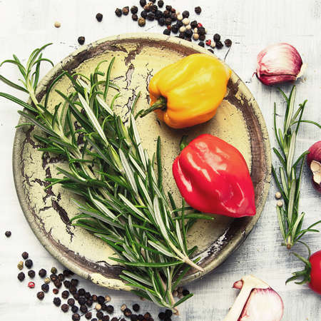 Fresh rosemary, vegetables and spices. Healthy cooking concept. Top view