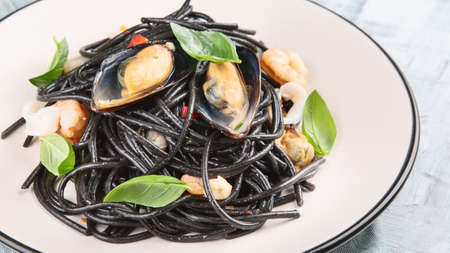 Italian black pasta with seafood.