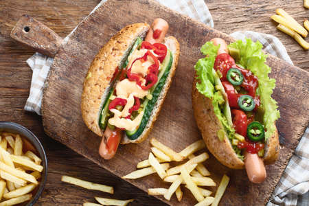 Delicious homemade hot dogs with sausages and fresh vegetables