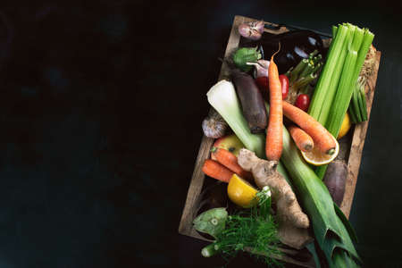 Local fresh raw vegetables in wooden box with copy space. Top view