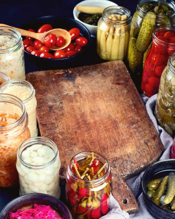 Fermented preserved food. Marinated pickles vegetables in glass jars.