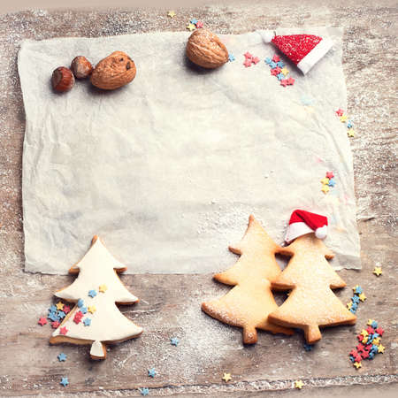 Christmas cookies on rustic wooden background. Flat lay with copy space