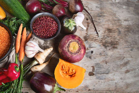 Healthy organic food. Mixed legumes and vegetables on rustic background with copy space