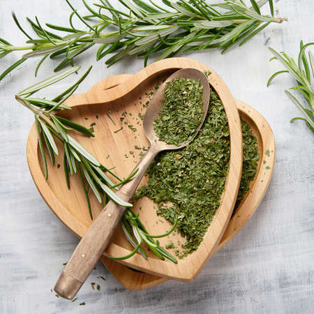 Dried rosemary with fresh rosemary twigs. Top view