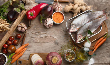 Cooking ingredients on rustic wooden board. Healthy lifestyle and food concept. Top view with copy space