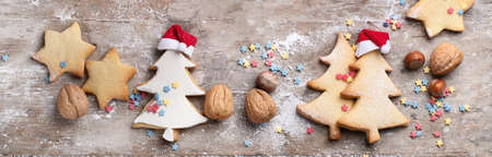 Christmas cookies  on rustic wooden background. Top view. Panorama