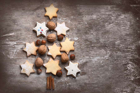 Christmas cookies tree on rustic wooden background. Top view Stock Photo