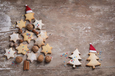 Christmas cookies tree on rustic wooden background. Top view with copy space Stock Photo