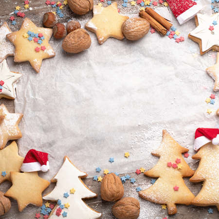Christmas cookies on rustic wooden background. Top view with copy space