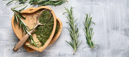 Dried rosemary with fresh rosemary twigs. Top view. Panorama with copy space