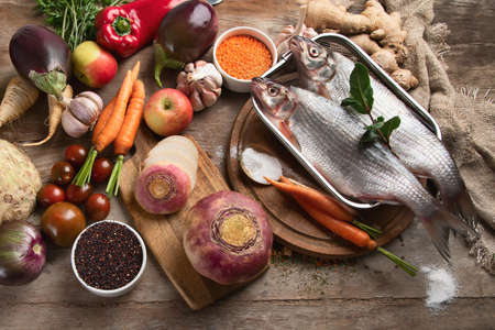 Cooking ingredients on rustic wooden board. Healthy lifestyle and food concept. Top view