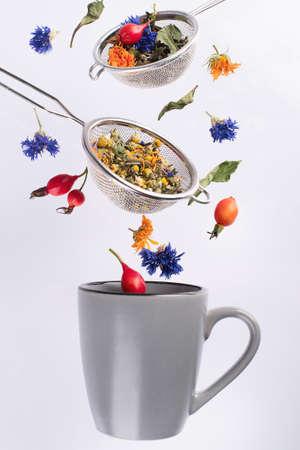 Flying herbal tea. Healthy diet concept. Stock Photo