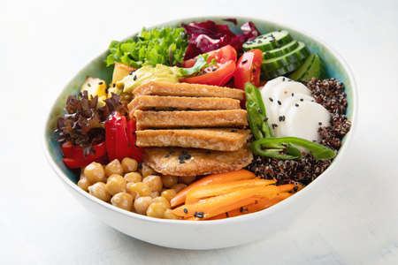 Buddha bowl with tofu.  Healthy vegan and vegetarian food concept 免版税图像 - 113033841