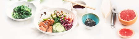 Salmon poke bowl. Traditional Hawaiian fish salad. Panorama