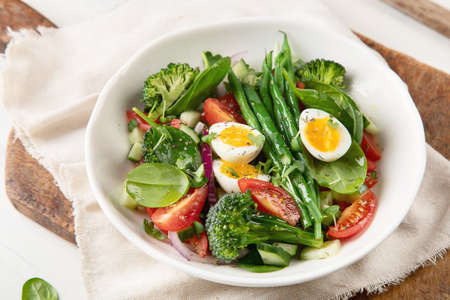 Fresh vegetables  salad with eggs, green beans, broccoli and tomatoes. Diet menu. Healthy eating