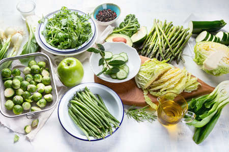 Green vegetables for healthy cooking. Vegetarian and vegan food. Healthy diet eating concept. Top view Stock Photo