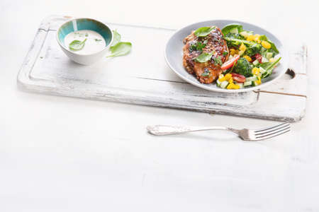 Chicken breast with fresh vegetable salad. Healthy diet menu with copy space