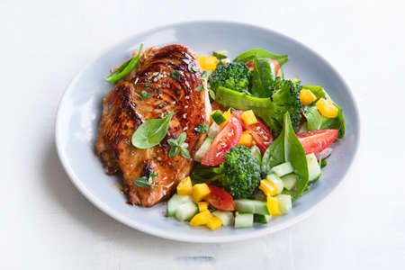 Chicken breast with fresh vegetable salad. Healthy diet menu. Top view, flat lay Stock Photo