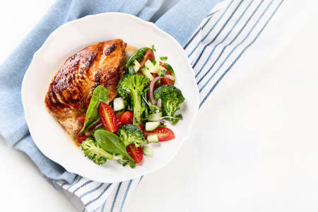 Chicken breast with fresh vegetable salad. Healthy diet menu. Top view, flat lay with copy space Stock Photo