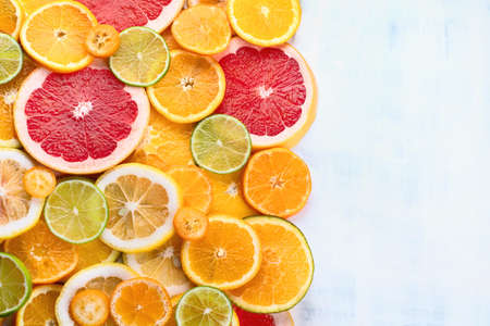 Fresh citrus fruits colorful background. Top view, flat lay with copy space