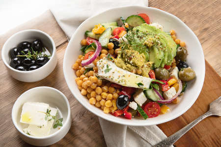 Salad with chickpeas, feta and avocado. Healthy diet food