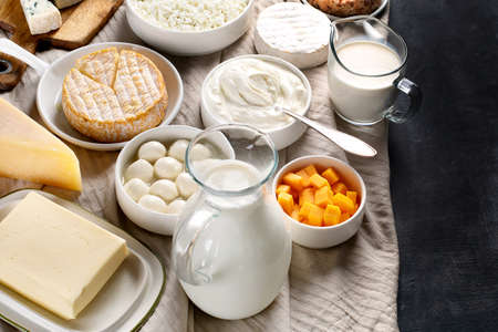 Dairy products.  Milk, cheese, sour cream, cottage, yogurt and butter on dark background Stock Photo