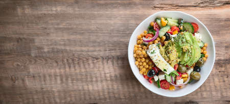 Salad with chickpeas, feta and avocado. Healthy diet food.