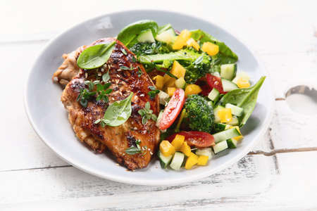 Chicken breast with fresh vegetable salad. Healthy diet Stock Photo