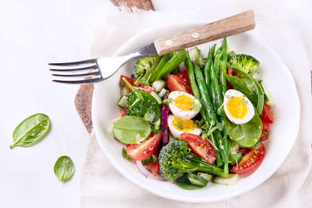 Vegetables  salad with eggs, green beans, broccoli and tomatoes. Diet menu. Healthy eating Stock Photo