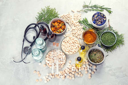 Alternative medicine herbs and homeopathic globules. Homeopathy medicine concept Stockfoto