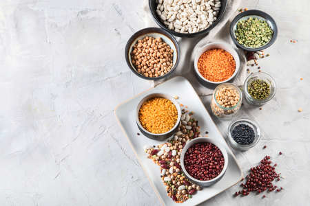 Assortment of colorful legumes. Healthy eating concept. Vegan proteins.  Top view with copy space