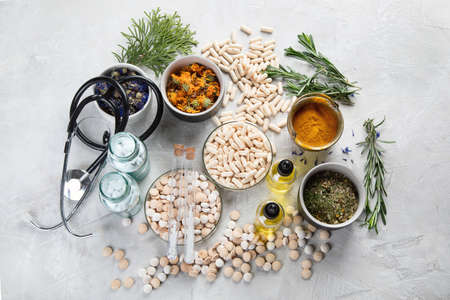 Alternative medicine herbs and homeopathic globules. Homeopathy medicine concept Stock Photo