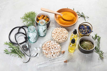 Alternative medicine herbs and homeopathic globules. Homeopathy medicine concept