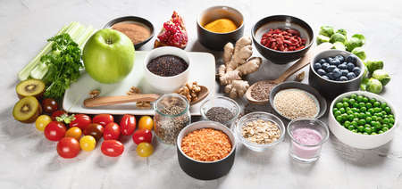 Vegetables, fruit, grain, superfoods for vegan and vegetarian eating. Clean eating. Detox, dieting food concept. Stock Photo