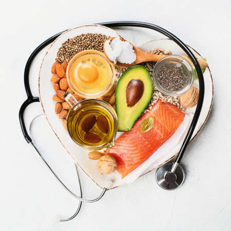 Selection of healthy fat sources. Healthy dieteating concept.Top view, flat lay