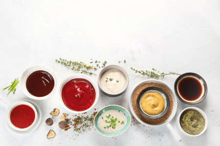 Bowls of various sauces Imagens