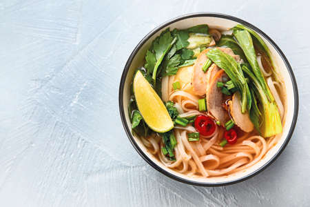 Asian noodle soup. Top view with copy space