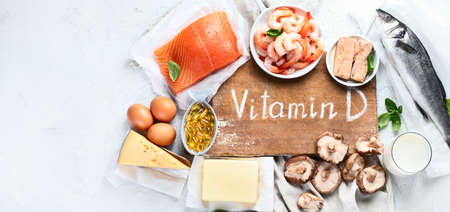 Foods rich in natural vitamin D. Balanced diet nutritio. Healthy eating concept. Panorama, banner with copy space Imagens