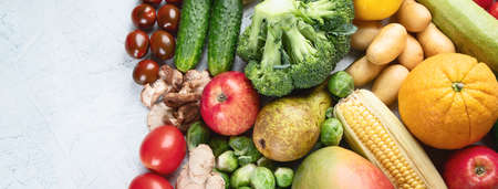 Assortment of fresh fruits and vegetables.  Detox, vegan and clean diet eating. Top view, flat lay with copy space  Stock Photo