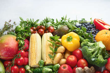 Assortment of fresh fruits and vegetables.  Detox, vegan and clean diet eating.