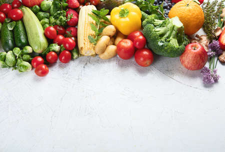 Assortment of fresh fruits and vegetables.  Detox, vegan and clean diet eating. Top view with copy space  Stock Photo