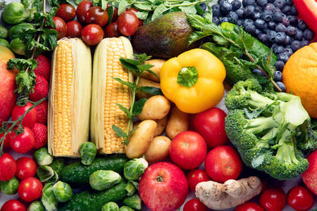 Assortment of fresh fruits and vegetables.  Detox, vegan and clean diet eating.  Stock Photo