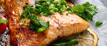 Grilled Salmon with lemon and herb. Healthy diet eating. Panorama, banner.. Selective focus Фото со стока