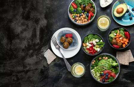 Healthy vegetarian dinner table setting. Healthy cooking concept. Clean eating, vegan food. Top view with copy space.